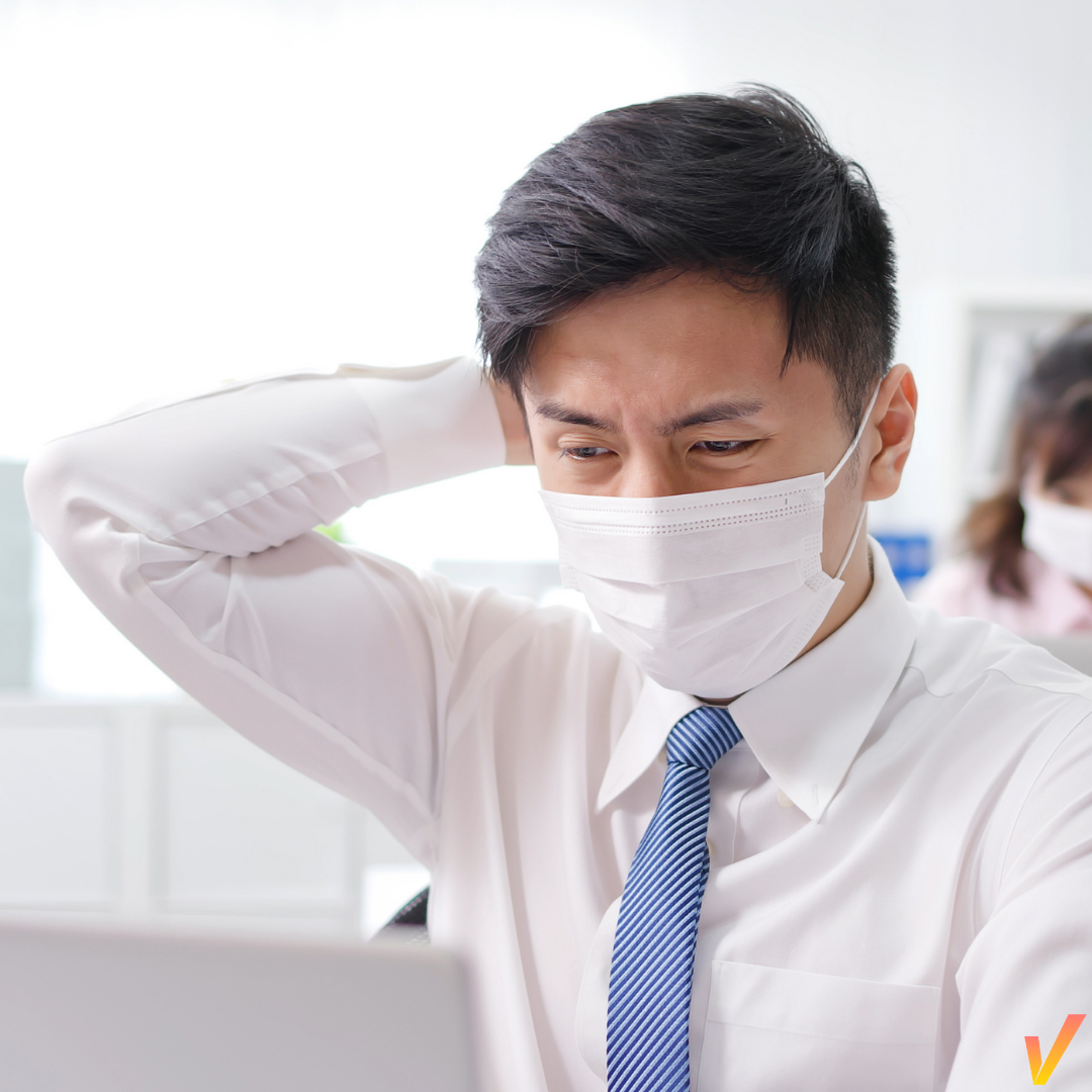 Employees in masks returning to work